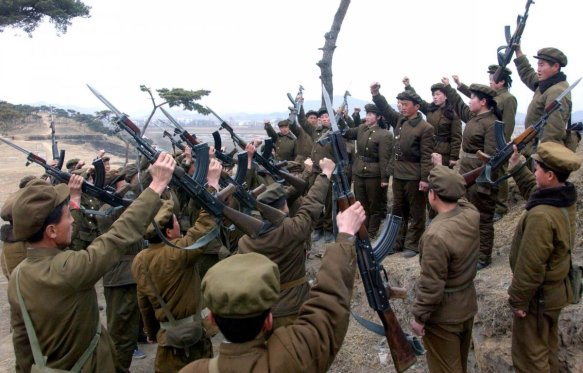 members-of-the-worker-peasant-red-guards-the-civilian-forces-of-north-korea-shout-slogans-in-an-undisclosed-location